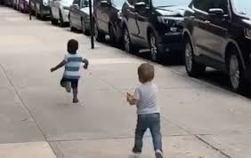 Stillshot of video showing toddlers fleeing one another