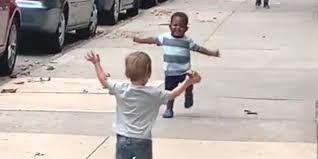 Stillshot of video showing toddlers embracing